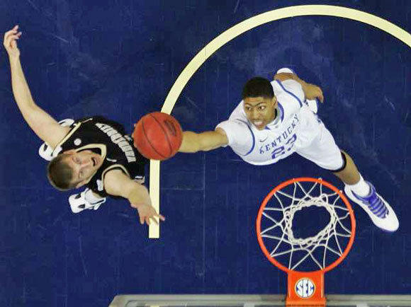 Kentucky's Anthony Davis shoots over Vanderbilt's Brad Tinsley in the SEC tournament final on Sunday. The Commodores upset the Wildcats, 71-64, but Kentucky is still the top seed in the South Regional of the NCAA tournament.