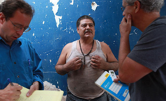 Abraham Caudel, center, talks to Chicago Tribune reporters David Jackson, left, and Gary Marx in September at his brother's tannery shop in Guadalajara, Mexico. Caudel fled the U.S. eight years ago after he was charged with sexually assaulting his 14-year-old daughter.