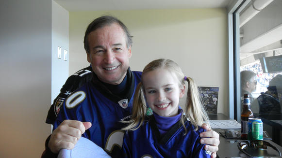 Mayo A. Shattuck III and his 9-year-old daughter Lillian at M&T Bank Stadium.