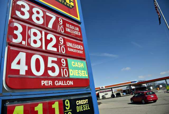 Gas prices are displayed outside a Pilot Travel Center in Princeton, Illinois on March 5.