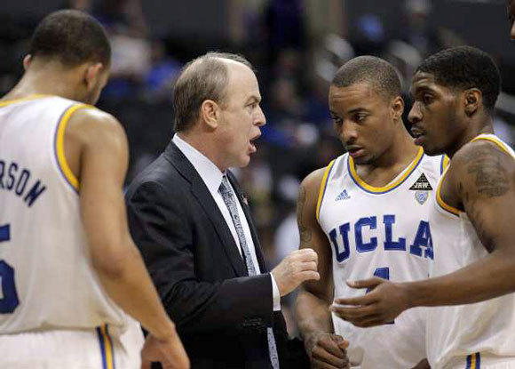 Ben Howland, center, talks to Lazeric Jones, right, and Norman Powell during the first half of the game against USC on March 7.