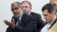 MECCA board member Syed Hussain makes his case for the variance approval during a meeting of the  DuPage County Development Committee Tuesday, March 6, 2012 in Wheaton. (Chuck Berman/Chicago Tribune)