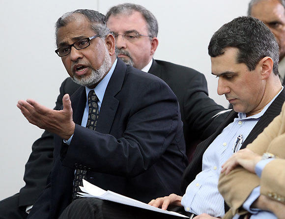MECCA board member Syed Hussain makes his case for the variance approval during a meeting of the DuPage County Development Committee Tuesday, March 6, 2012 in Wheaton.