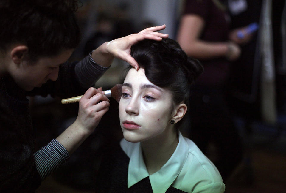 """Models prepare for the Glasgow School of Art Fashion show in Glasgow, Scotland. Third year textiles and fashion students unveil their striking new collections, inspired by the idea of movement. The Glasgow School of Art has produced some of the most celebrated designers of recent years, notably <a class=""""taxInlineTagLink"""" id=""""PRDCAS0000595"""" title=""""Jonathan Saunders"""" href=""""/topic/services-shopping/clothing-accessories-shoes/jonathan-saunders-PRDCAS0000595.topic"""">Jonathan Saunders</a>."""