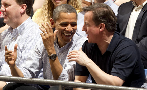 Barack Obama talks with British prime minister David Cameron before the game between the Western Kentucky Hilltoppers and Mississippi Valley State Delta Devils.