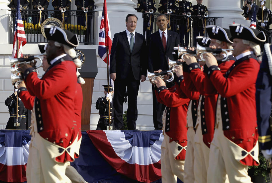 U.S. President Barack Obama (R) British Prime Minister David Cameron watch during the official arrival ceremony on the South Lawn of the White House March 14, 2012 in Washington, DC. Prime Minister Cameron was on a three-day visit.