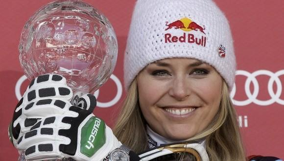 Lindsey Vonn with the trophy for downhill season title.