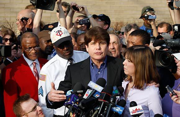 Former Gov. Rod Blagojevich and his wife, Patti, address the media one last time outside his house on the night before he heads off to prison.