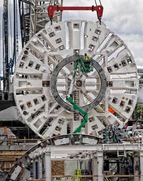 "A worker prepares the ""Cutter Head""  of the Port Tunnel boring machine for attachment to the tunneling machine on September 1, 2011 in Miami, Florida. The $45 million machine is longer than a football field and about as tall as a four-story building and it will carve the twin tunnels connecting Watson Island and Dodge Island. The the new $1 billion Port of Miami tunnel is expected to be completed in May of 2014."