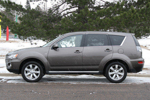 The 2012 Outlander starts at $22,345 for the two-row base model. Cars.com's Courtney Messenbaugh tested the highest trim, the GT S-AWC with all-wheel drive and three rows of seats. The Navigation Package and Touring Package add leather upholstery, a power-adjustable driver's seat and a moon roof. The SUV cost $33,605 as tested.