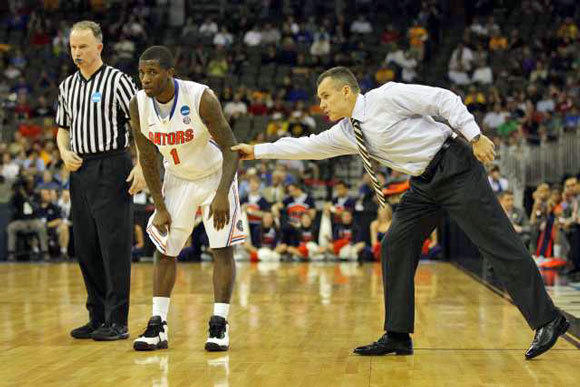 Head Coach Billy Donovan of the Florida Gators gets the attention of Kenny Boynton during the game against Virginia.