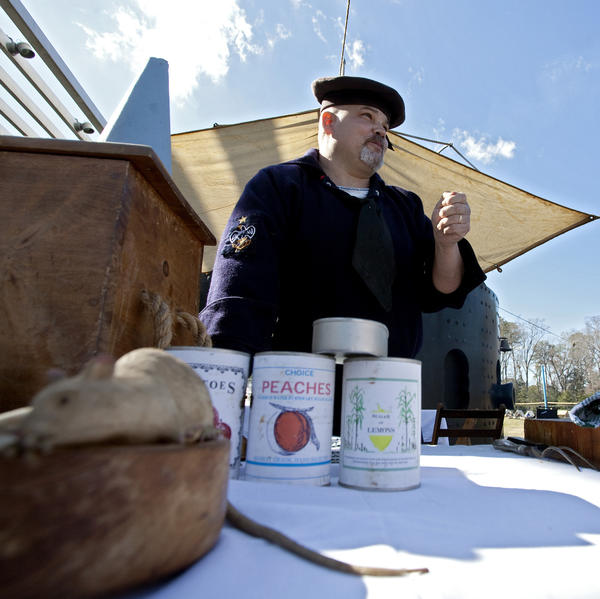 Eric Jeanneret speaks to visitors while preparing oyster stew and bean soup during a cook-off at the Mariners' Museum in Newport News on Saturday, March 10. The museum held a cook-off between two Civil War-era cooks as a part of weekend festivities marking the 150th anniversary of the Battle of Hampton Roads.
