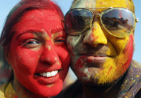 Revelers pose while celebrating the Indian festival of Holi on a boat cruise around part of Manhattan on March 17, 2012 in New York City. The Hindu festival of Holi , also known as the Festival of Colors, marks the arrival of spring where participants throw colored powder and water on one another. Many of the New York participants are Indian-American.