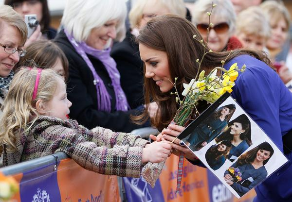 Britain's Catherine, Duchess of Cambridge speaks with a girl in the crowd during a visit to The Treehouse in Ipswich, eastern England, on March 19, 2012. The Duchess of Cambridge visited to formally opened The Treehouse, a children's hospice service.