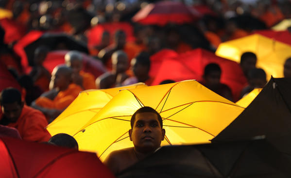 Sri Lankan Buddhist monks protest in Colombo on March 19, 2012. US-led move to censure Sri Lanka at the ongoing UN Human Rights Council sessions in Geneva over its alleged war crimes while crushing Tamil rebels in 2009.