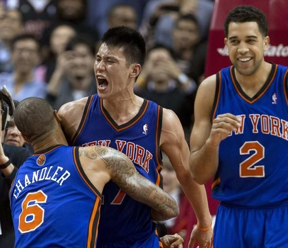 Jeremy Lin, center, celebrates with teammates Tyson Chandler, left, and Landry Fields after hitting a game-winning three-pointer with less than half a second left to lift the Knicks to a 90-87 victory over the Toronto Raptors in February.