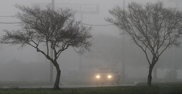 Fog clouds the view of drivers during their morning commute on Warwick Blvd. near Tabbs Lane Tuesday.