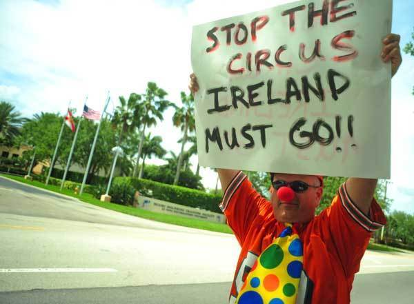 Miami Dolphin fan Brad London of Pembroke Pines protests in front of the Dolphins Training Facility in Davie, Tuesday.