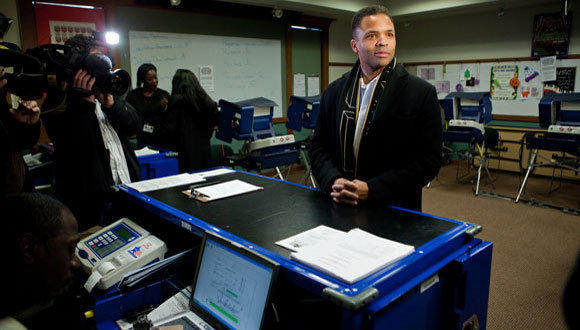 Rep. Jesse Jackson, Jr. waits for his ballot to cast his early vote at Jeffery Manor Library in Chicago on Friday, March 9, 2012.