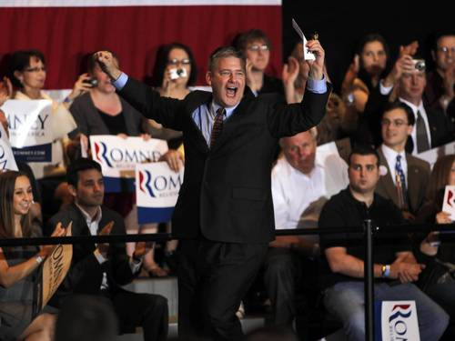 Illinois Treasurer Dan Rutherford rushes out to introduce Republican presidential candidate Mitt Romney during an election night event at the Renaissance Schaumburg Convention Center in Schaumburg.