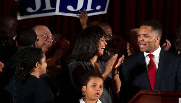 Rep. Jesse Jackson, Jr. celebrates with his wife, Ald. Sandi Jackson, after declaring victory Tuesday.