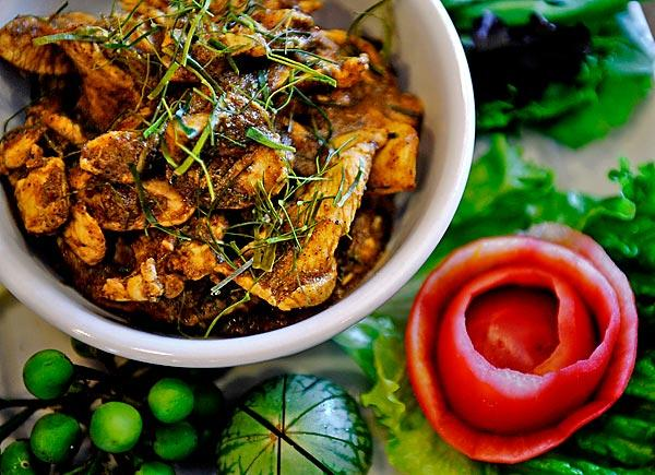 Kuah gling with chicken is a southern-style dry meat curry.