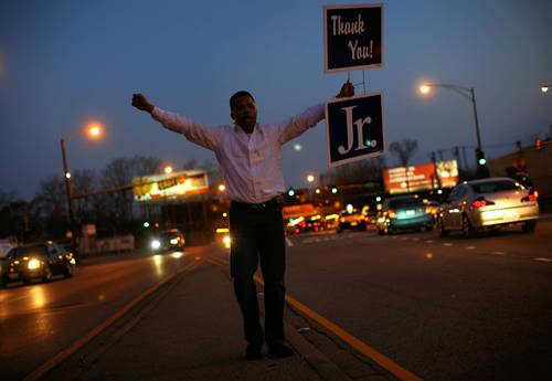 U.S. Rep. Jesse Jackson Jr. thanks voters at the intersection of 95th and Stony Island after winning the 2nd Congressional District primary.