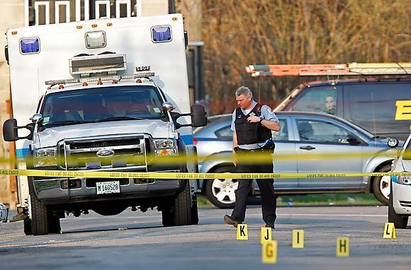 Chicago police investigate a shooting in the 3100 block of West 15th Place in Chicago on Wednesday.