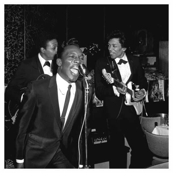 Wilson Pickett wails into the microphone as young Jimi Hendrix, right, plays along in 1966.