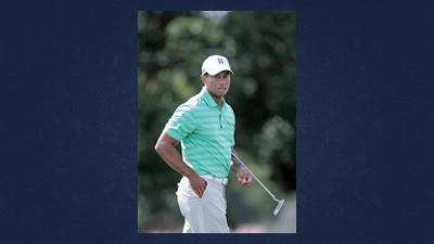 Tiger Woods studies his putt on the 15th green during the Pro-Am round at the Arnold Palmer Invitational golf tournament at Bay Hill, Wednesday, in Orlando, Fla.