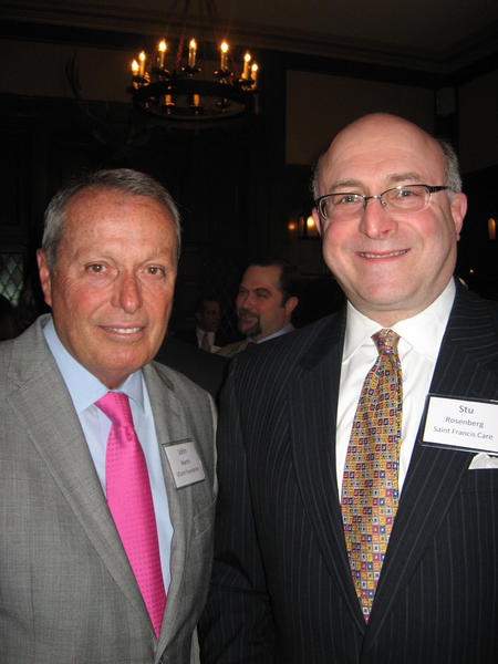 John Martin, left, of the UConn Foundation, and Stu Rosenberg of St. Francis Care.