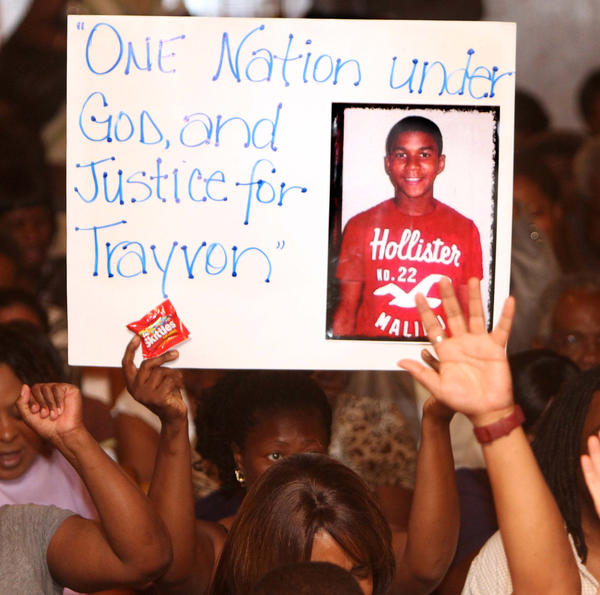 Protesters at the Allen Chapel AME Church in Sanford, Fla., Tuesday night, March 20,  2012, where a meeting hosted by the NAACP was being held to address community concerns in the shooting of Trayvon Martin.