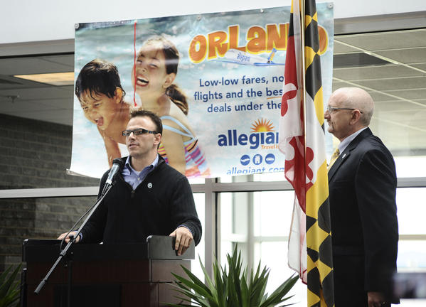 Eric Fletcher, director of airports for Allegiant Air, announces Thursday that Allegiant will be providing passenger air service to Orlando, Fla., from Hagerstown Regional Airport beginning in May. At right is Hagerstown Regional Airport Director Phil Ridenour.