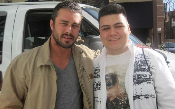 Actor Taylor Kinney poses for a photo with a fan outside of his Gold Coast hotel March 6, 2012.