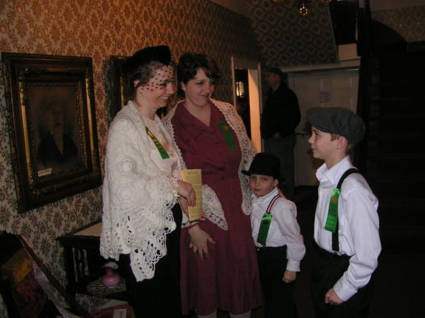 Family volunteering: Sisters Windy Kretchman and her son, Levi, 9, and Aileen Reiber, and her son, Ben, 5, were volunteers in Maple Manor for last year's Pennsylvania Maple Festival. Their children love to help out in the historic home every year.