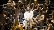 "Paul Nolan, center, as Jesus and Chilina Kennedy, lower left of center, as Mary Magdalene in ""Jesus Christ Superstar."""