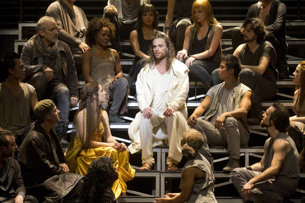 """Paul Nolan, center, as Jesus and Chilina Kennedy, lower left of center, as Mary Magdalene in """"Jesus Christ Superstar."""""""