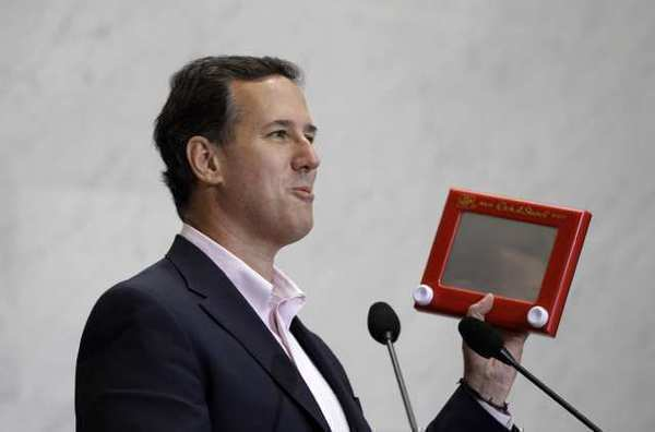 Republican presidential candidate Rick Santorum holds an Etch A Sketch during a campaign stop Thursday.