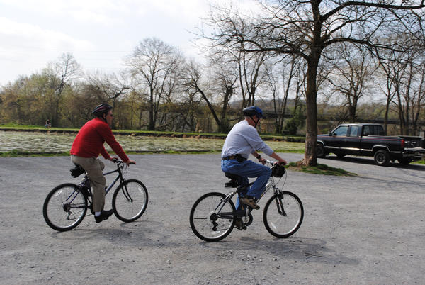 Smithsburg resident Mike Baliff, left, 70, and Hagerstown resident Tom Lowe, right, 67, went out bike riding along the Chesapeake and Ohio Canal towpath Thursday afternoon.