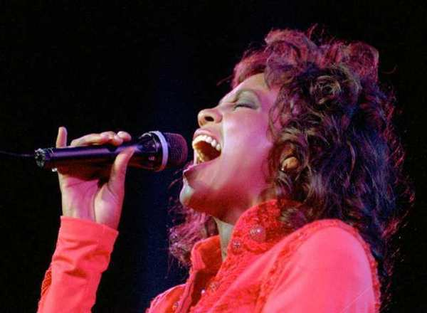 Whitney Houston performs in Anaheim in 1994. On Thursday, Los Angeles health officials said that the singer died in an accidental drowning. Cocaine and heart disease were also factors in her death.