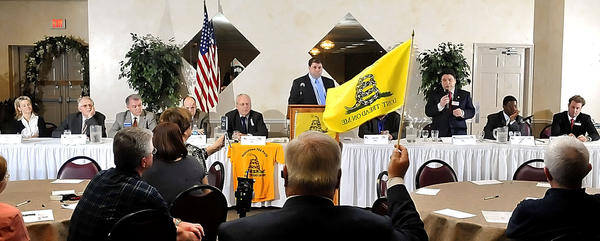 "A yellow ""Don't Tread on Me"" flag is raised to alert a candidate time is up during the Hagerstown Tea Party's forum for 6th District Congressional candidates Thursday evening at Next Dimensions"