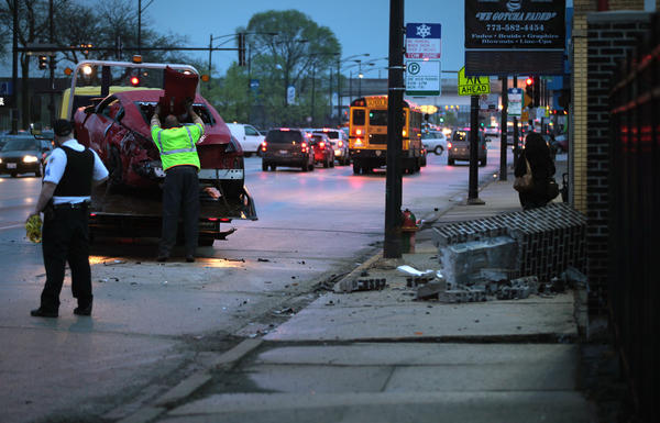 A woman was killed and three other people were injured in a car crash this morning in the Archer Heights neighborhood, police said. A car rear-ended another at 4950 S. Pulaski Road about 4 a.m. and then ran into a pole, police said.