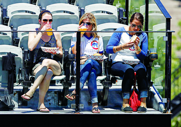 Fans dig into lunch at the Brixen Ivy rooftop before the Chicago Cubs play the San Francisco Giants in the first game of a doubleheader Tuesday, June 28, 2011 at Wrigley Field. (Brian Cassella/ Chicago Tribune) B581296249Z.1 ....OUTSIDE TRIBUNE CO.- NO MAGS, NO SALES, NO INTERNET, NO TV, NEW YORK TIMES OUT, CHICAGO OUT, NO DIGITAL MANIPULATION...