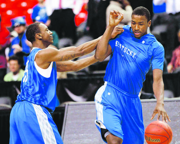 The play of UK point guard Marquis Teague, left, joking around with Michael Kidd-Gilchrist on Thursday, has not been a surprise to Xavier guards  Justin Martin and Jeff Robinson.