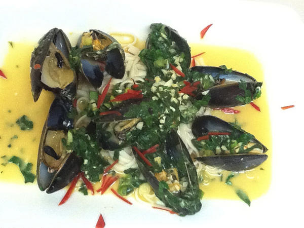 Sue McGlaughlin, owner of Toski Sands Market in Petoskey, created the dish seen here, which features mussels in a coconut Thai curry sauce.