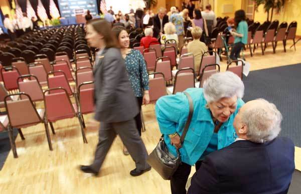 Gloria Goldberg gives her husband, Wynmoor Community Council President, Howard Goldberg, a kiss in the ballroom at Wynmoor Village in Coconut Creek on Friday, March 23, 2012. Howard Goldberg will introduce Vice President Biden before his remarks at the condo community.