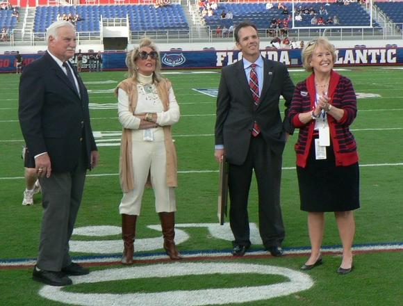 From left, Howard Schnellenberger, Beverlee Schnellenberger, Craig Angelos and Mary Jane Saunders at Schnellenberger's final game as coach in Decmeber.