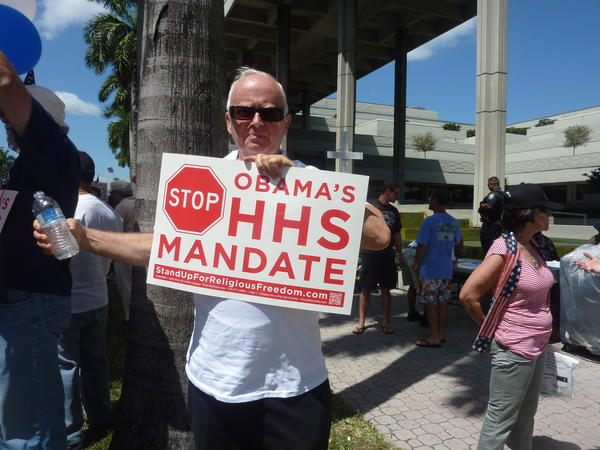 Walt Benner, of Boca Raton, joins nearly 100 people gathered at Broward Boulevard and 3rd Street in Fort Lauderdale Friday to protest President Obama's health-care plan.