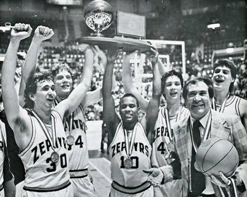 Whitehall players and coach Dick Tracy celebrate their state title in Hershey on March 27, 1982.
