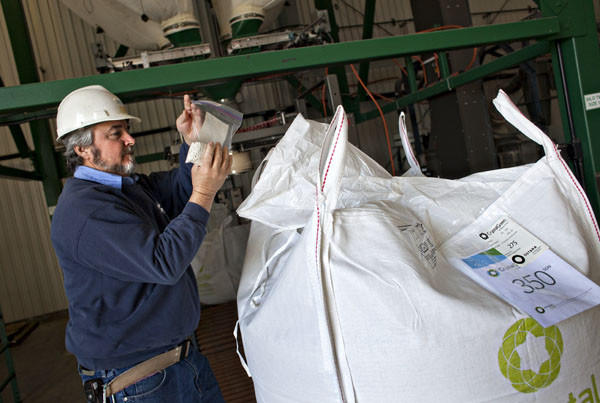 Tim Bell, a lead operator, takes a bag of sample from a fertilizer product, 'Crystal Green', at Hampton Roads Sanitation District's Nansemond Treatment Plant in Suffolk on Monday, March 12, 2012. Nutrient recovery process equipment recovers nutrients from wastewater and transform them into the fertilizer product.